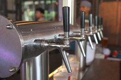 Beer tap in a row Stock Image