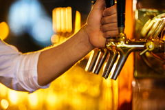 Beer tap. Waiter with beer tap in pub Royalty Free Stock Photography