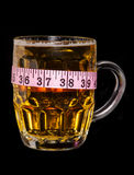 Beer with tape measure Royalty Free Stock Images