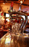 Beer-taps in a bar Stock Photos