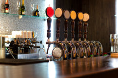 Beer taps behind a bar counter Stock Image