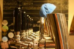 Beer taps and black handles in a beer bar Stock Photo