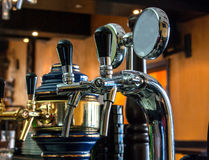 Beer taps. Chrome cobra style beer taps set up in a pub Royalty Free Stock Photography