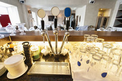 Beer taps and glasses at bar counter Royalty Free Stock Photography