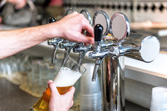 Beer taps and goblet. With fresh tasty beer Royalty Free Stock Images