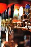Beer Taps Inside Pub Stock Photo