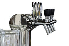 Beer taps isolated over white Royalty Free Stock Image