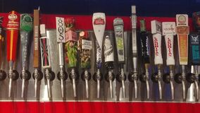 Beer Taps. Lots of beer taps and all are micro brewery beer taps Stock Photos