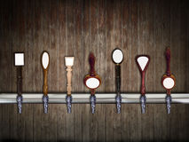 Beer taps. Multiple beer taps in a row Stock Photography
