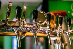 Beer taps in a pub. Royalty Free Stock Photos