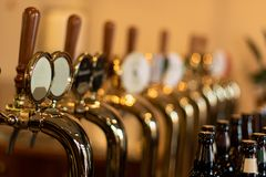 The beer taps in a pub with different kinde of craft beer royalty free stock photography