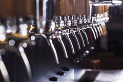 Beer taps in a pub. The beer taps in a pub. nobody. Selective focus Stock Image