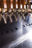 Beer taps in a pub. The beer taps in a pub. nobody. Selective focus Royalty Free Stock Image