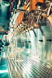 Beer taps in a pub. The beer taps in a pub. nobody. Selective focus. Alcohol concept. Vintage style. Beer craft. Bar table. Steel taps. Shiny taps Stock Photo