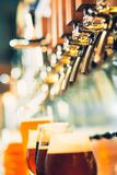 Beer taps in a pub royalty free stock image