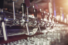 Beer taps in pub. Shiny silver beer taps in pub Stock Photos