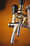Beer taps in a pub. Soft focus on a beer taps Stock Photography