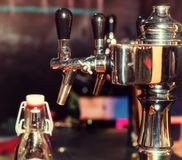 Beer taps in row at restaurant or pub Royalty Free Stock Photography