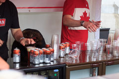 The beer tent at Canada Day 2017 celebrations in London. Canada Day celebrations 2017 in Trafalgar Square in London.  Crowds of happy people wearing Canadian Stock Images