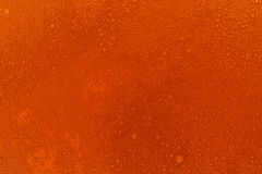 Red beer texture. Colored background stock photography
