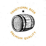 Beer themed logo with wooden beer cask. Traditional beer, premium quality - beer themed logo with this phrase and wooden beer cask. Retro-styled beer badge Royalty Free Stock Photos