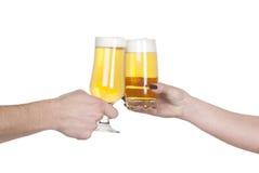 Beer toast. Between man and woman Stock Photos
