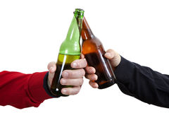 Beer Toast. Two friends toasting with beer bottles Royalty Free Stock Photos