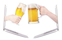Beer toasting to show internet business success. Isolated royalty free stock photo