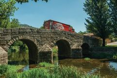 Beer truck passing over old bridge on the Sever River in Portagem royalty free stock photos