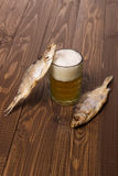 Beer and two fishes Royalty Free Stock Photography