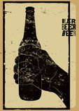 Beer typographical vintage style grunge poster. The hand holds an empty bottle of beer. Retro vector illustration. Royalty Free Stock Photo
