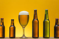 Beer. Various bottles with different types of beer and a glass of beer Royalty Free Stock Images