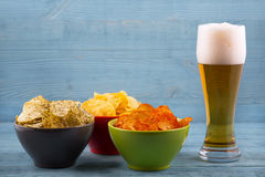 Beer and various types of chips Royalty Free Stock Photography