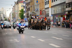 A beer waggon with police escort makes its way through traffic. Police motorcycles escort a beer waggon through traffic, as it makes its way to the gathering Royalty Free Stock Photo