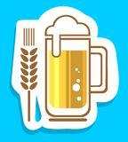 Beer and wheat ear Stock Photos