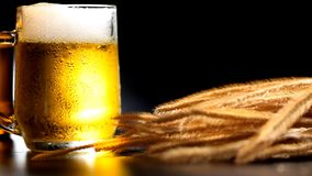 Beer With Wheat. On table with black background stock video footage