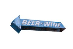 Beer and Wine Arrow. This is a blue and white, retro, steel and neon arrow shaped sign with the words beer and wine isolated on a white background Royalty Free Stock Photo