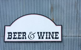Beer and Wine Sign. On light blue background Royalty Free Stock Photography