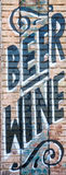 Beer and Wine. Sign painted on a brick wall for beer and wine Stock Photo