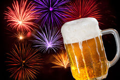 Beer With Fireworks Stock Photo