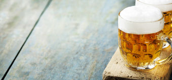 Beer on wood background Royalty Free Stock Photo