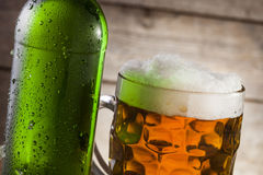 Beer. On a wooden background with copyspace Stock Image