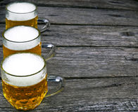 Beer on wooden background Stock Images