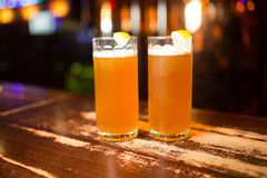 Beer on the wooden bar in pub. Beer on the wooden bar Royalty Free Stock Photo