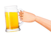 Beer with wooden hand making toast. Isolated on a white background Royalty Free Stock Photo