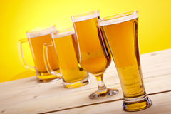 Beer on wooden table Royalty Free Stock Images
