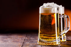 Beer on wooden table Stock Photo