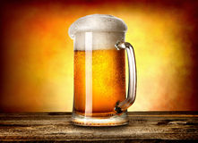 Beer on yellow background Royalty Free Stock Photography