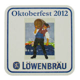Beermat drink coaster isolated. BERLIN, GERMANY - MARCH 15, 2015: Beermat of German beer Loewenbraeu isolated over white background Royalty Free Stock Image