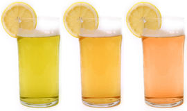 Beers. 3 shades of beer with a slice of fresh lemon Royalty Free Stock Images